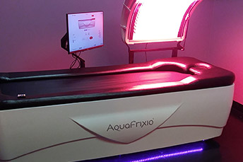 water massage bed with red light inside salon